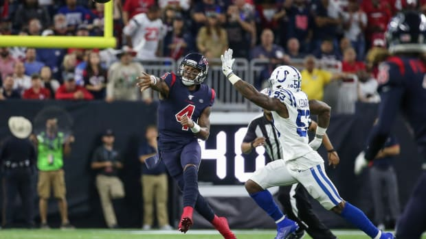 Houston Texans quarterback Deshaun Watson passes while getting pressure from Indianapolis Colts linebacker Darius Leonard in a 2019 game in Houston.