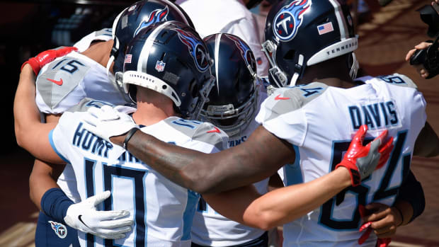 Tennessee Titans wide receiver Corey Davis (84), wide receiver Adam Humphries (10) and the rest of the receivers get ready to take the field at Nissan Stadium.
