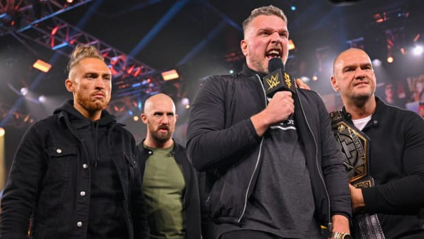 WWE's Pat McAfee in the ring with a microphone on NXT