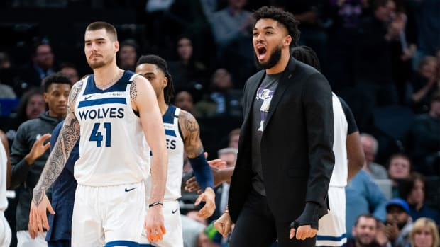 Feb 12, 2020; Minneapolis, Minnesota, USA; Minnesota Timberwolves center Karl-Anthony Towns (32) celebrates in the fourth quarter against the Charlotte Hornets at Target Center.
