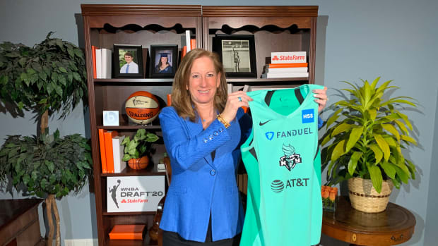 WNBA Commissioner Cathy Engelbert holds New York Liberty jersey