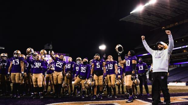 Jimmy Lake and his team celebrate beating Utah.