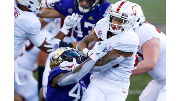 Dec 5, 2020; Seattle, Washington, USA; Stanford Cardinal running back Austin Jones (20) rushes against the Washington Huskies during the first quarter at Alaska Airlines Field at Husky Stadium.