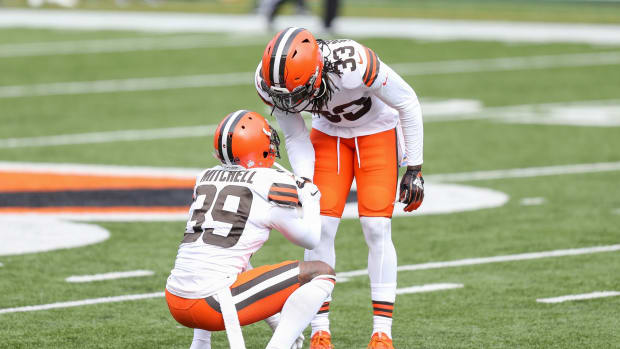 Cleveland Browns cornerback Terrance Mitchell (39) shakes hands with safety Ronnie Harrison (33) against the Cincinnati Bengals in the first half at Paul Brown Stadium.