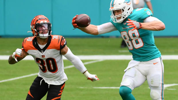 Dec 6, 2020; Miami Gardens, Florida, USA; Miami Dolphins tight end Mike Gesicki (88) makes a one handed catch in front of Cincinnati Bengals free safety Jessie Bates (30) during the second half at Hard Rock Stadium. Mandatory Credit: Jasen Vinlove-USA TODAY Sports