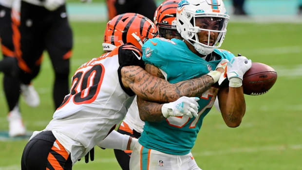 Dec 6, 2020; Miami Gardens, Florida, USA; Cincinnati Bengals free safety Jessie Bates (30) forces Miami Dolphins running back Myles Gaskin (37) to fumble the ball during the second half at Hard Rock Stadium. Mandatory Credit: Jasen Vinlove-USA TODAY Sports