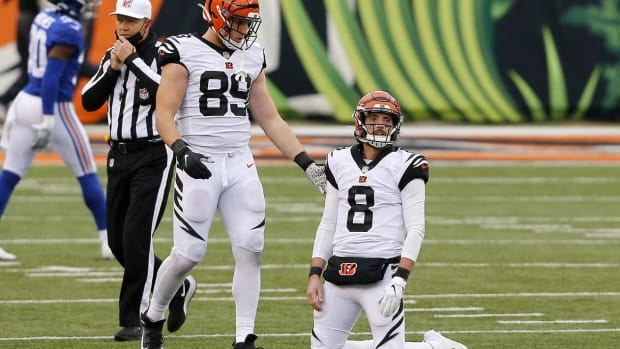 Nov 29, 2020; Cincinnati, Ohio, USA; Cincinnati Bengals quarterback Brandon Allen (8) is consoled by tight end Drew Sample (89) after his fumble to end the team s chance at a comeback win against the New York Giants at Paul Brown Stadium. Mandatory Credit: Joseph Maiorana-USA TODAY Sports