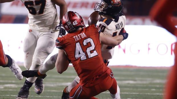 Dec 5, 2020; Salt Lake City, Utah, USA; Utah Utes defensive end Mika Tafua (42) sacks Oregon State Beavers quarterback Chance Nolan (10) on the final drive of the game at Rice-Eccles Stadium.