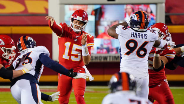 Kansas City Chiefs quarterback Patrick Mahomes (15) throws a pass ahead of Denver Broncos defensive end Shelby Harris (96) during the first half at Arrowhead Stadium.