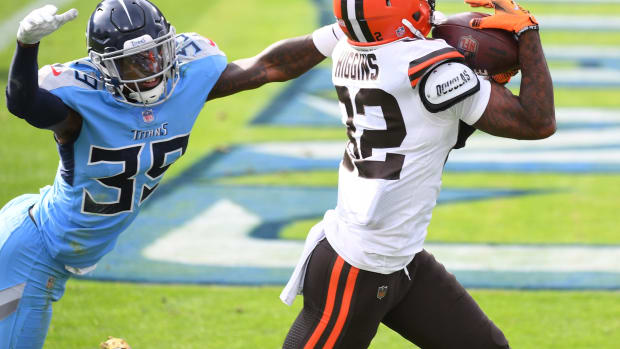 Dec 6, 2020; Nashville, Tennessee, USA; Cleveland Browns wide receiver Rashard Higgins (82) catches a touchdown pass behind coverage from Tennessee Titans cornerback Breon Borders (39) during the first half at Nissan Stadium. Mandatory Credit: Christopher Hanewinckel-USA TODAY Sports