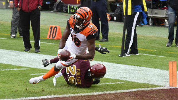 Nov 22, 2020; Landover, Maryland, USA; Cincinnati Bengals wide receiver A.J. Green (18) scores a touchdown as Washington Football Team cornerback Kendall Fuller (29) defends during the second quarter at FedExField. Mandatory Credit: Brad Mills-USA TODAY Sports