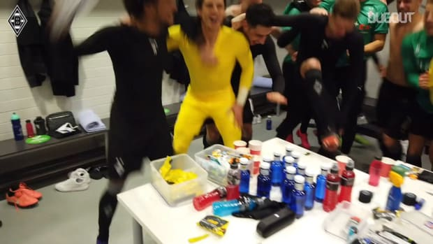 Gladbach stars celebrate qualifying for the Champions League round of 16