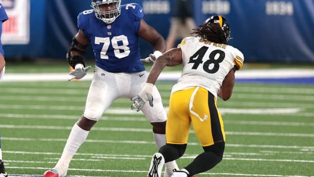 Sep 14, 2020; East Rutherford, New Jersey, USA; New York Giants offensive tackle Andrew Thomas (78) blocks Pittsburgh Steelers outside linebacker Bud Dupree (48) during the second half at MetLife Stadium.