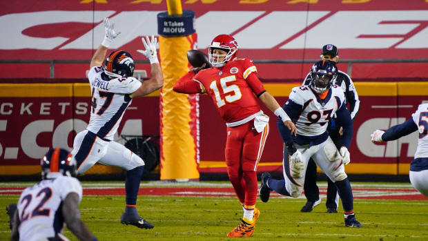 Kansas City Chiefs quarterback Patrick Mahomes (15) throws a pass while pressured by Denver Broncos inside linebacker Josey Jewell (47) during the second half at Arrowhead Stadium.