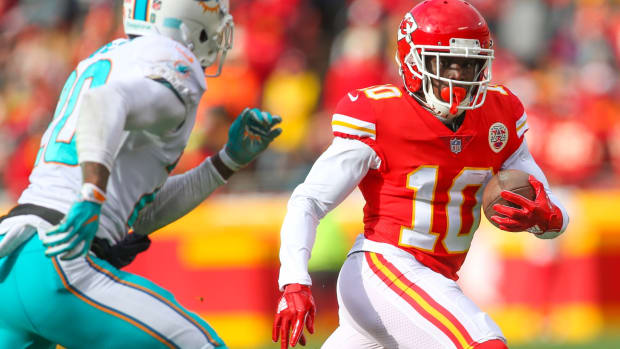 Dec 24, 2017; Kansas City, MO, USA; Kansas City Chiefs wide receiver Tyreek Hill (10) runs against Miami Dolphins safety Reshad Jones (20) in the first half at Arrowhead Stadium. Mandatory Credit: Jay Biggerstaff-USA TODAY Sports