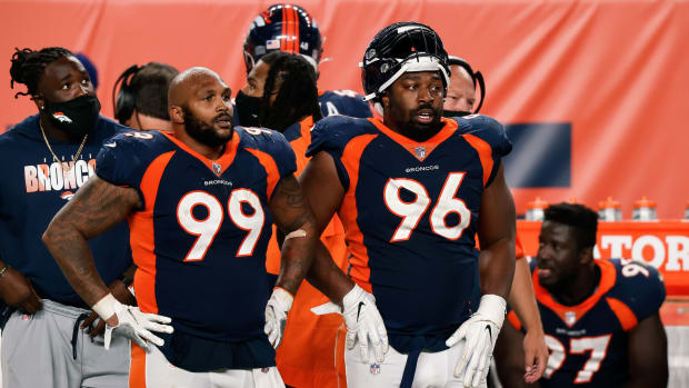Denver Broncos defensive end Jurrell Casey (99) and defensive end Shelby Harris (96) in the fourth quarter against the Tennessee Titans at Empower Field at Mile High.