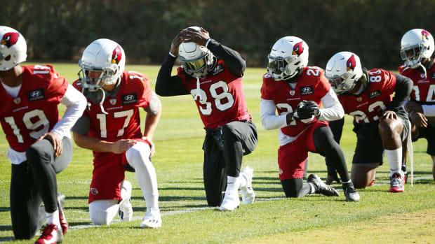 Dec 9, Tempe, Arizona, USA; Arizona Cardinals running back Jonathan Ward (38) adjusts his helmet during practice at Dignity Health Training Facility.