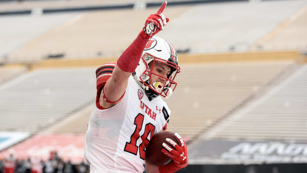 Dec 12, 2020; Boulder, Colorado, USA; Utah Utes wide receiver Britain Covey (18) celebrates after scoring a touchdown against the Colorado Buffaloes in the third quarter at Folsom Field.
