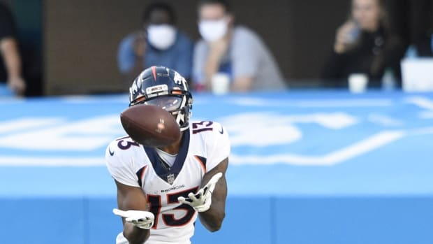 Denver Broncos wide receiver KJ Hamler (13) catches a touchdown pass in the fourth quarter at Bank of America Stadium.
