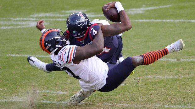 Deshaun Watson taken down for a sack by the Bears.