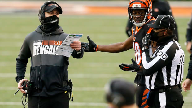 Cincinnati Bengals head coach Zac Taylor and wide receiver A.J. Green (18) appeal to an official after a play is ruled dead in the second quarter of the NFL Week 14 game between the Cincinnati Bengals and the Dallas Cowboys at Paul Brown Stadium in downtown Cincinnati on Sunday, Dec. 13, 2020. The Cowboys led 17-7 at half time. Dallas Cowboys At Cincinnati Bengals