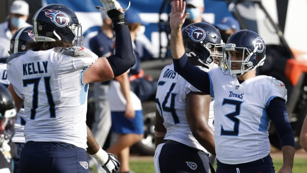 Tennessee Titans offensive tackle Dennis Kelly (71) congradulates place kicker Stephen Gostkowski (3) after a field goal during the second half against the Jacksonville Jaguars at TIAA Bank Field.