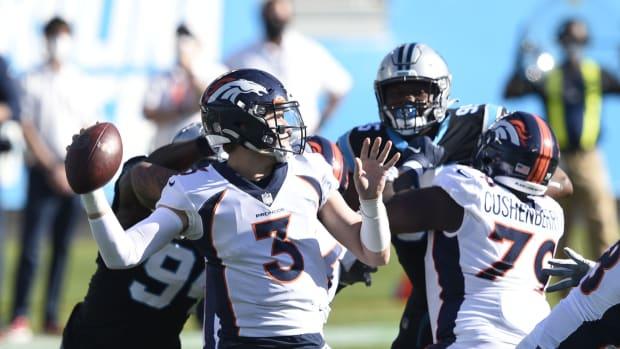 Denver Broncos quarterback Drew Lock (3) looks to pass the first quarter at Bank of America Stadium.