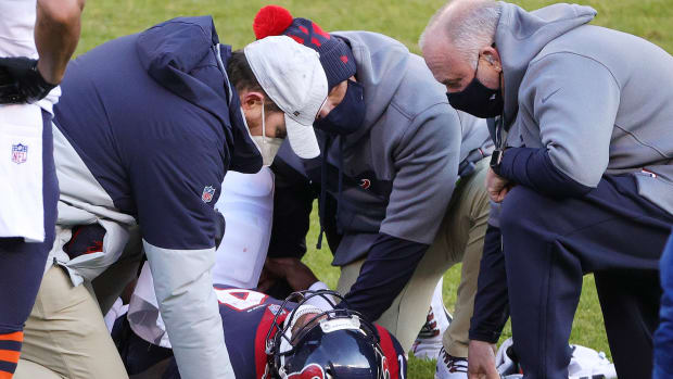Deshaun Watson being attended to after a big hit