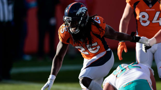 Denver Broncos running back Melvin Gordon III (25) celebrates after scoring a touchdown in the first quarter against the Miami Dolphins at Empower Field at Mile High.