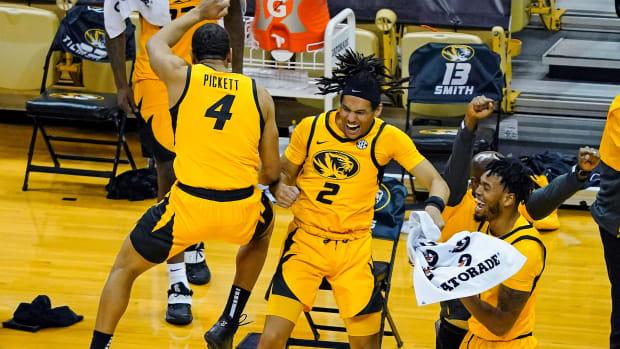 Missouri basketball celebrates during a win over rival Illinois