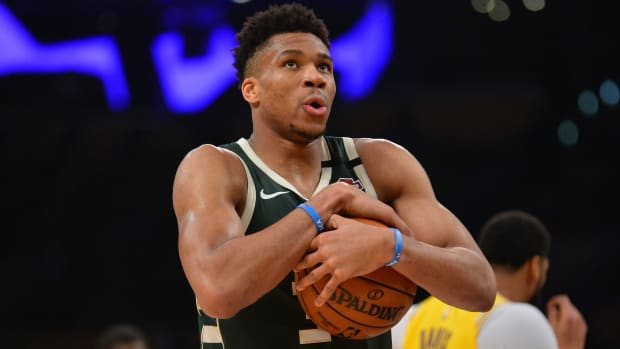 Milwaukee Bucks forward Giannis Antetokounmpo (34) reacts against the Los Angeles Lakers during the second half at Staples Center.