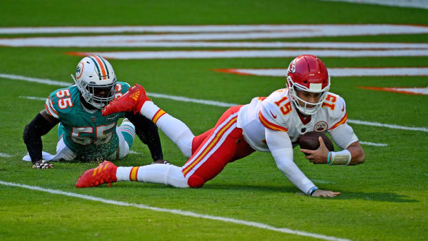 Dec 13, 2020; Miami Gardens, Florida, USA; Miami Dolphins outside linebacker Jerome Baker (55) sacks Kansas City Chiefs quarterback Patrick Mahomes (15) during the first half at Hard Rock Stadium. Mandatory Credit: Jasen Vinlove-USA TODAY Sports