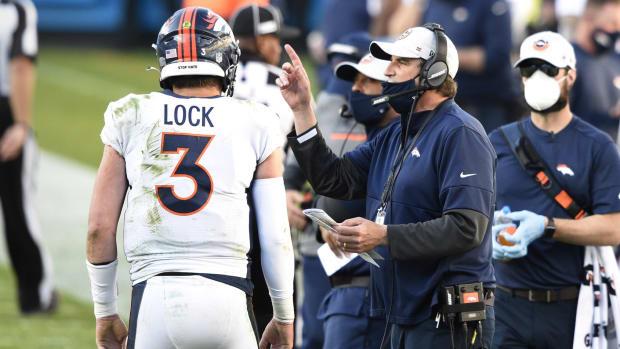 Denver Broncos quarterbacks coach Mike Shula with quarterback Drew Lock (3) in the fourth quarter at Bank of America Stadium.
