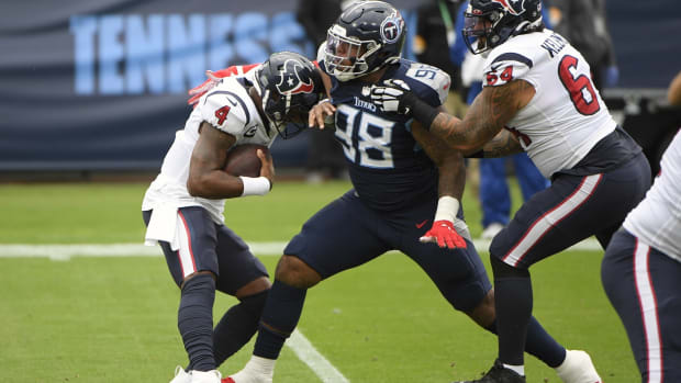 Tennessee Titans defensive tackle Jeffery Simmons (98) sacks Houston Texans quarterback Deshaun Watson (4) during first half at Nissan Stadium.
