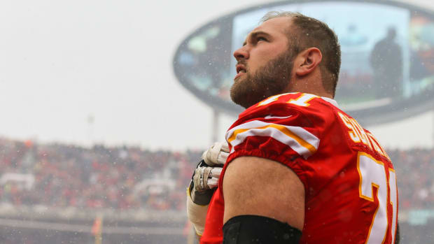 Jan 12, 2019; Kansas City, MO, USA; Kansas City Chiefs offensive tackle Mitchell Schwartz (71) observes the national anthem before an AFC Divisional playoff football game against the Indianapolis Colts at Arrowhead Stadium. Mandatory Credit: Jay Biggerstaff-USA TODAY Sports