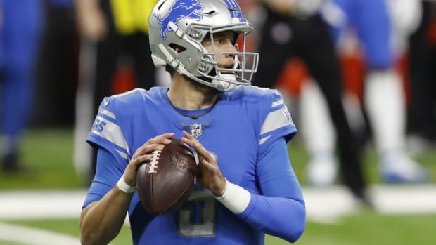 Detroit Lions quarterback Matthew Stafford (9) looks to pass during the first quarter against the Green Bay Packers at Ford Field.