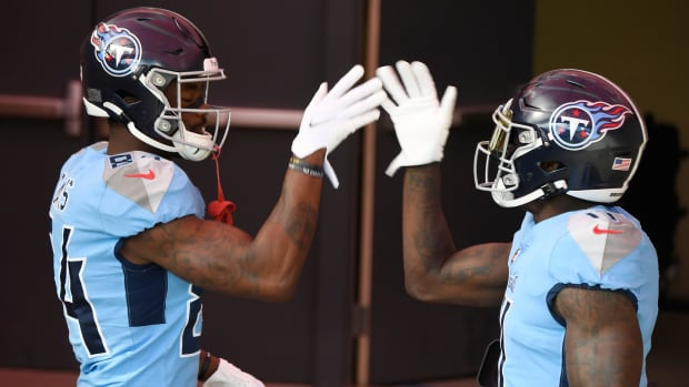 Tennessee Titans wide receivers Corey Davis (84) and A.J. Brown (11) slap hands before the game against the Cleveland Browns at Nissan Stadium Sunday, Dec. 6, 2020 in Nashville, Tenn.