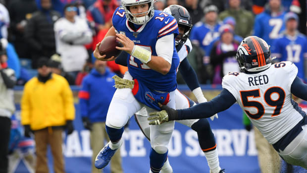 Buffalo Bills quarterback Josh Allen (17) avoids the tackle attempt of Denver Broncos linebacker Malik Reed (59) while running with the ball during the second quarter at New Era Field.