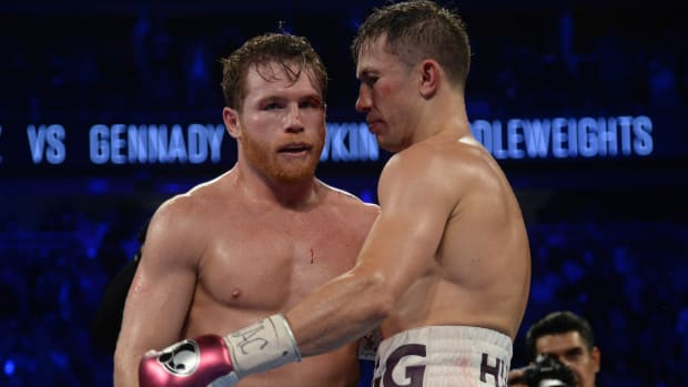 Canelo Alvarez (black trunks) and Gennady Golovkin (white trunks) hug after their middleweight world championship boxing match at T-Mobile Arena.