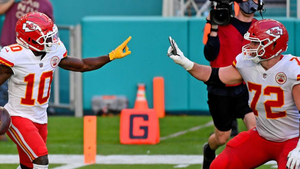 Dec 13, 2020; Miami Gardens, Florida, USA; Kansas City Chiefs wide receiver Tyreek Hill (10) celebrates his touchdown against the Miami Dolphins with offensive tackle Eric Fisher (72) during the second half at Hard Rock Stadium. Mandatory Credit: Jasen Vinlove-USA TODAY Sports