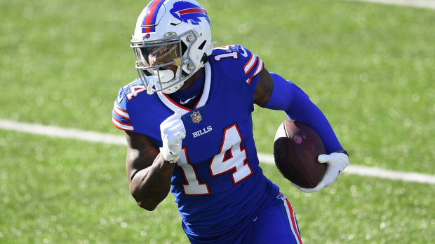 Buffalo Bills wide receiver Stefon Diggs (14) runs with the ball after a catch against the Seattle Seahawks during the first quarter at Bills Stadium.