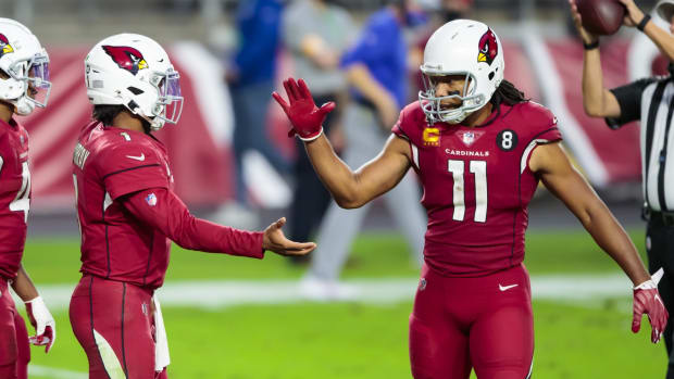 Arizona Cardinals quarterback Kyler Murray (1) celebrates Wirth wide receiver Larry Fitzgerald (11) after defeating the Buffalo Bills at State Farm Stadium.