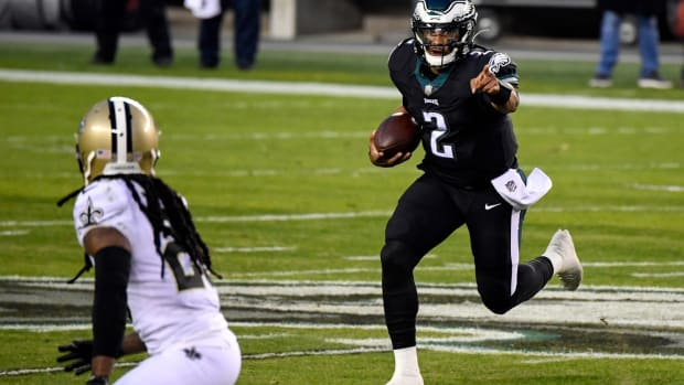 The Philadelphia Eagles' Jalen Hurts carries the ball against the New Orleans Saints on Sunday, Dec. 13, 2020, in Philadelphia.
