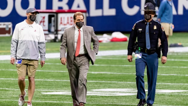 Nick Saban walks the field at SEC Championship Game