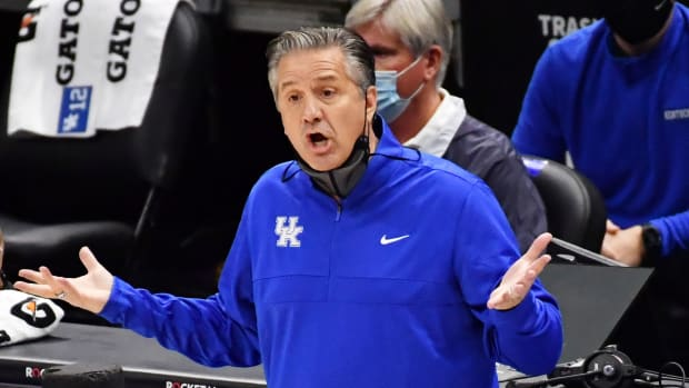 Kentucky coach John Calipari throws out his hands during a loss to UNC