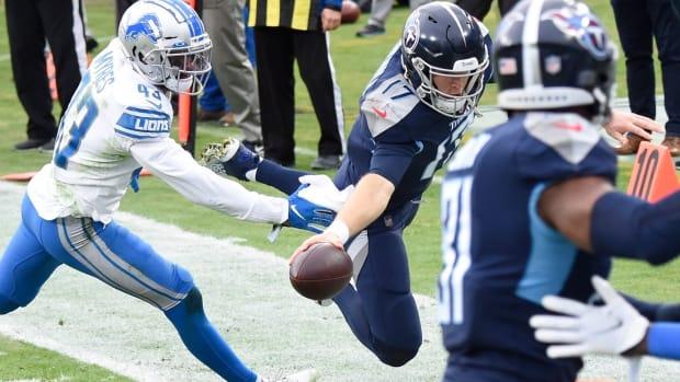 Tennessee Titans quarterback Ryan Tannehill (17) dives for a touchdown against Detroit Lions cornerback Alex Myres (43) during the second quarter at Nissan Stadium Sunday, Dec. 20, 2020 in Nashville, Tenn.