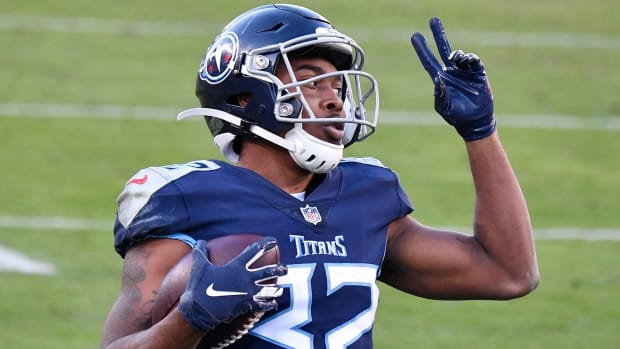 Tennessee Titans running back Darrynton Evans (32) celebrates his touchdown against the Detroit Lions during the fourth quarter at Nissan Stadium Sunday, Dec. 20, 2020 in Nashville, Tenn.