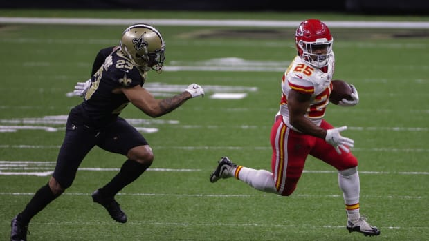 Dec 20, 2020; New Orleans, Louisiana, USA; Kansas City Chiefs running back Clyde Edwards-Helaire (25) runs against New Orleans Saints cornerback Marshon Lattimore (23) during the first half at the Mercedes-Benz Superdome. Mandatory Credit: Derick E. Hingle-USA TODAY Sports