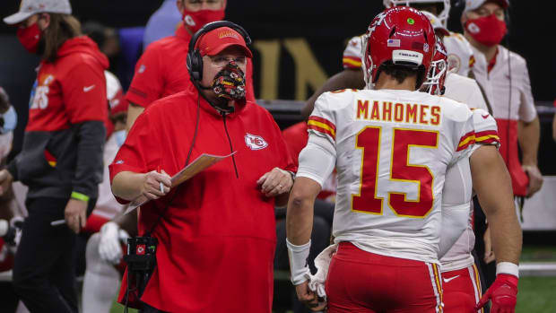 Dec 20, 2020; New Orleans, Louisiana, USA; Kansas City Chiefs head coach Andy Reid talks with quarterback Patrick Mahomes (15) during the first half against the New Orleans Saints at the Mercedes-Benz Superdome. Mandatory Credit: Derick E. Hingle-USA TODAY Sports