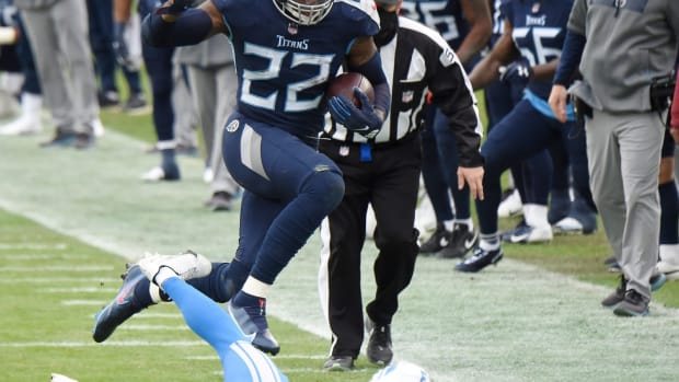 Tennessee Titans running back Derrick Henry (22) runs over Detroit Lions cornerback Alex Myres (43) after slamming him to the turf during the second quarter at Nissan Stadium Sunday, Dec. 20, 2020 in Nashville, Tenn.